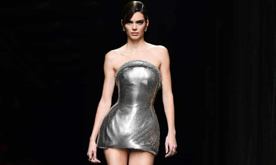 Kendall Jenner sports a short chainmail strapless gown worn at the Versace show