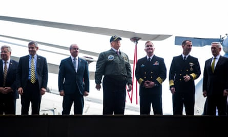 President Donald Trump and navy personnel on the USS Gerald R Ford aircraft carrier on 2 March.