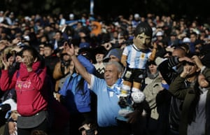 Argentina fan holds a doll representing Lionel Messi