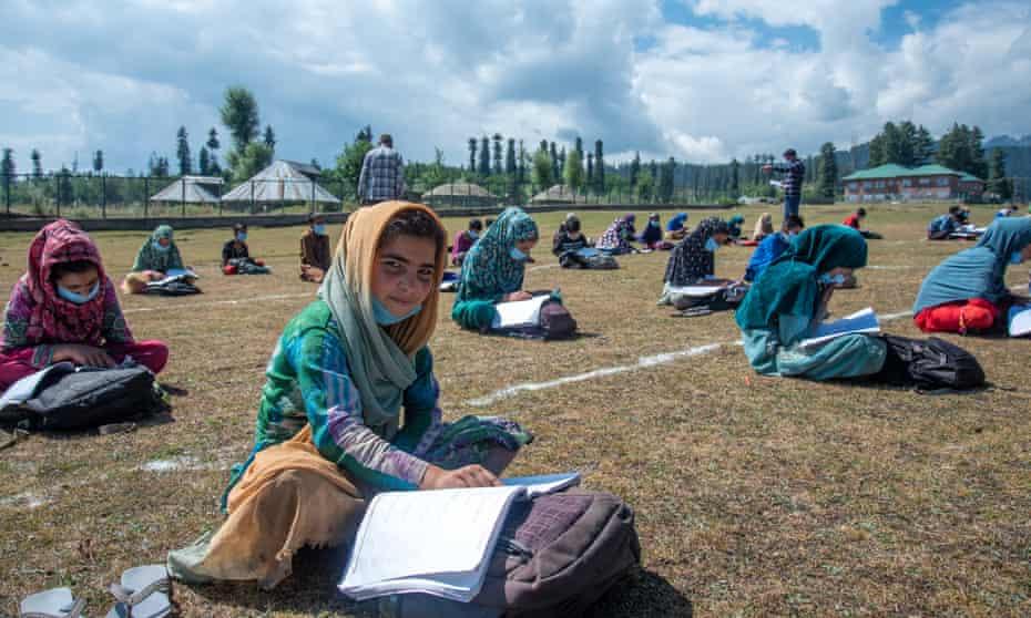 Pupils study in open-air classrooms in Doodpathri, Kashmir.