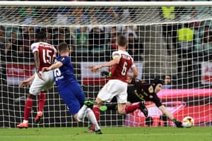 Olivier Giroud of Chelsea shoots as Petr Cech of Arsenal dives to save.