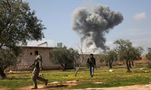 Turkish-backed Syrian opposition fighters are seen near Afrin as smoke billows from Kurdish positions.