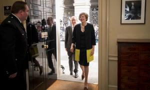Theresa May and husband Philip walk into 10 Downing Street