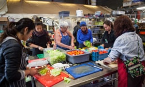Volunteers prepare meals for 2,000 in the Help Refugees kitchen.