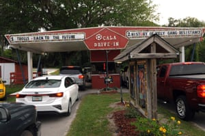 Cars queue at the ticket booth to enter the Ocala drive-in, one of the few movie theatres permitted to operate in Florid, United States