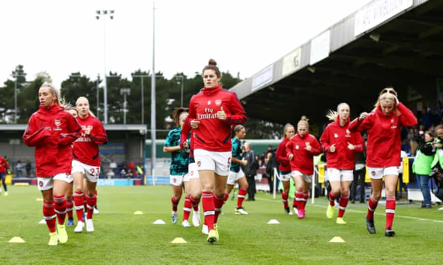 The Arsenal players warm up before the WSL game against Chelsea on Sunday, which they lost 2-1.