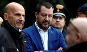 Matteo Salvini surrounded by officials in Rome