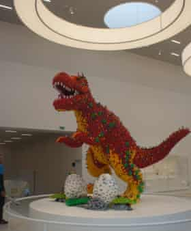 Prehistoric pain … a dinosaur steps on a Lego brick.