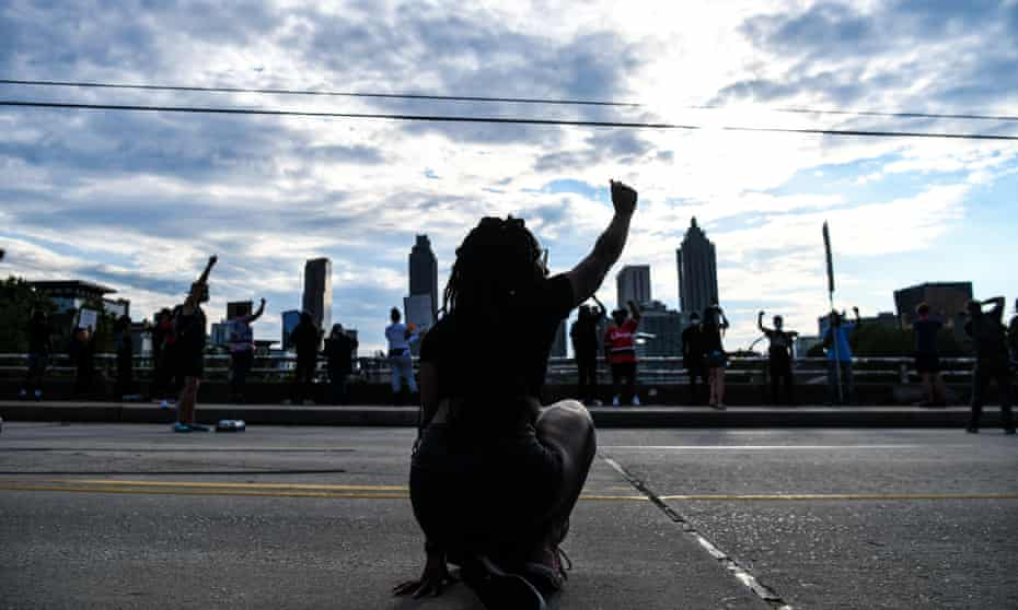 Protesters mark Juneteenth, 2020, in Atlanta, Georgia; the US marks the end of slavery by celebrating with an annual unofficial holiday.