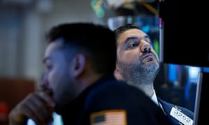 Traders at the New York Stock Exchange as Trump eases trade tensions