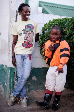 Prince Holder, the shortest jockey in Jamaica, between races