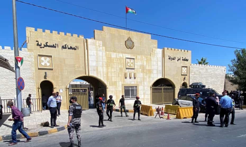 Security members stand guard outside the court in Amman where the two men were sentenced.