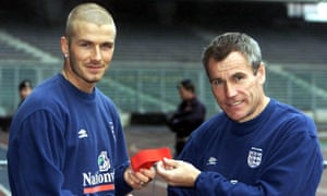 Peter Taylor gives the England captain's armband to David Beckham for the first time.