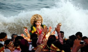 The goddess Durga represents the whole place, the whole community … the Durga Puja festival, India.