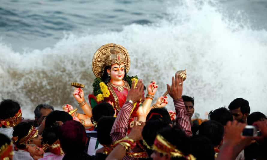 The goddess Durga represents the whole place, the whole community … the Durga Puja festival, India.
