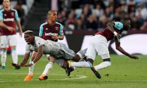 Manchester United's Paul Pogba and West Ham United's Cheikhou Kouyaté clash.