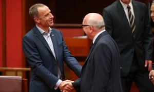 New Tasmanian Greens senator Nick McKim is congratulated by Attorney General George Brandis after making his first speech in the senate chamber of Parliament House Canberra this afternoon, Wednesday 9th September 2015.