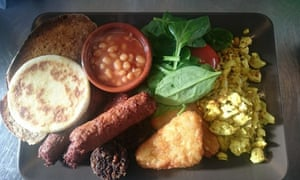 Shot from above of a plate of vegetarian food, including salad, beans and hummus at Teatime Collective, Manchester