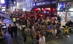 People eating at restaurant tables outside in Soho