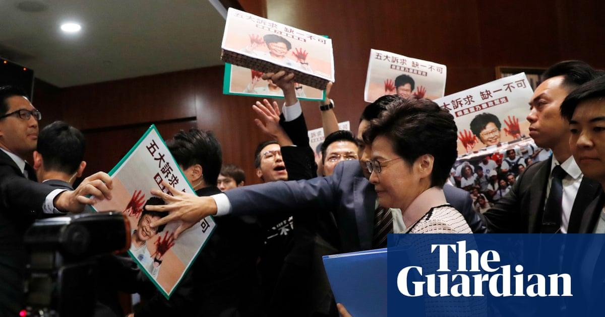 Hong Kong leader forced to deliver key address via video after lawmakers protest