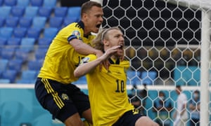 Sweden's Emil Forsberg, right, celebrates with Viktor Claesson after scoring his side's opening goal.