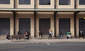People queue outside a Centrelink office in Preston, Melbourne, in March