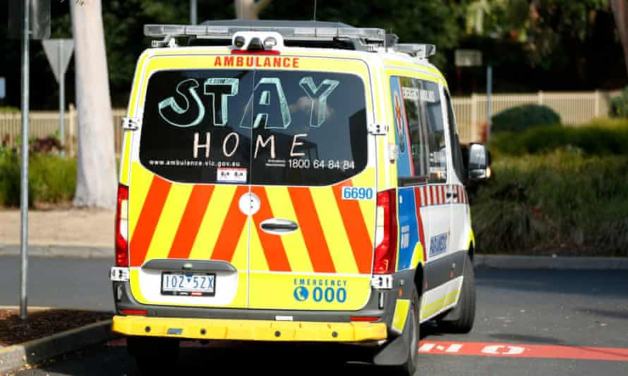 """Victoria ambulance with """"stay home"""" written on the back window"""