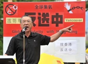 Rally organiser Kenneth Tung addresses demonstrators gathered in front of the Chinese consulate in Vancouver