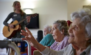 A music therapy group session at a care home. The report says considerable savings could be may be made if the progression of dementia could be delayed.