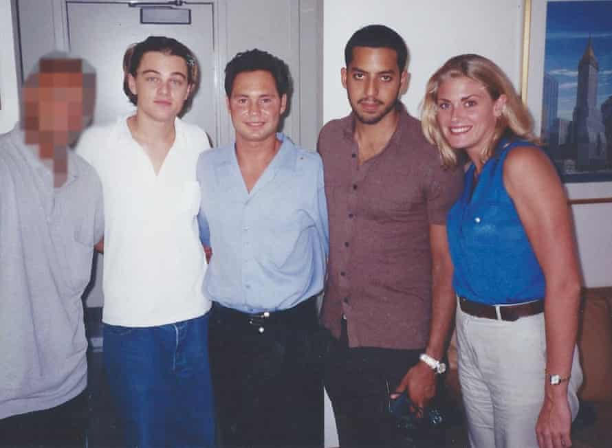 Amy seen in a photo with celebrities including Leonardo DiCaprio and David Blaine