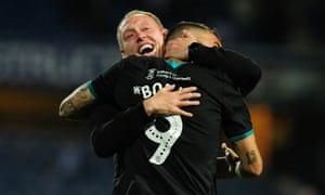 Swansea's head coach, Steve Cooper, embraces Borja Bastón after the win at QPR.