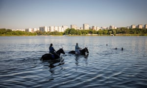 Moscow, Russia: Women cool their horses off in the water at Borisovskye Ponds.
