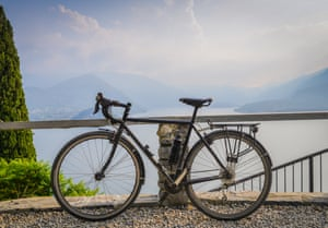 Touring bicycle next to railing with the beautiful view of Lake Como, Lombardy, Italy towards Bellagio. Captured in Varenna