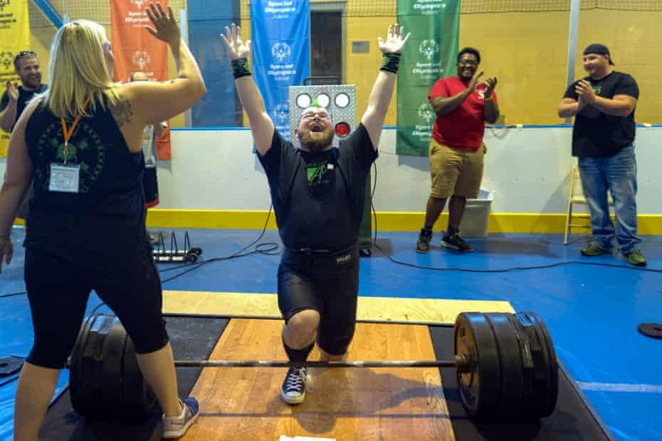 Andrew Dziezak celebrates his 450lb lift in power lifting.