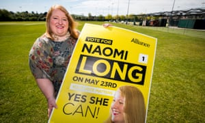 Naomi Long, Alliance party leader, with campaign poster