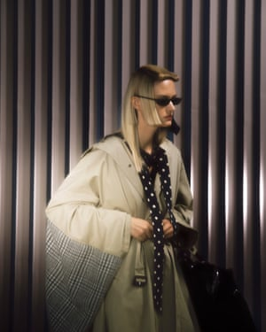 Trenchcoat, blouse, bag and sunglasses, all from a selection, balenciaga.com.
