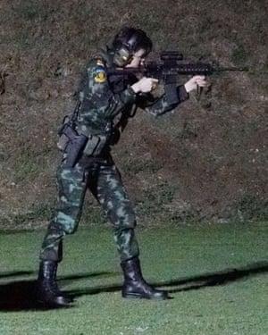 Sineenat Wongvajirapakdi at a firing range