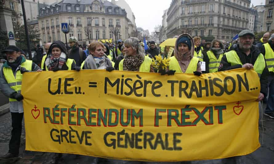 Gilets jaunes demonstrators march with an anti-EU banner calling for a referendum and general strike in Paris, 26 January 2019.