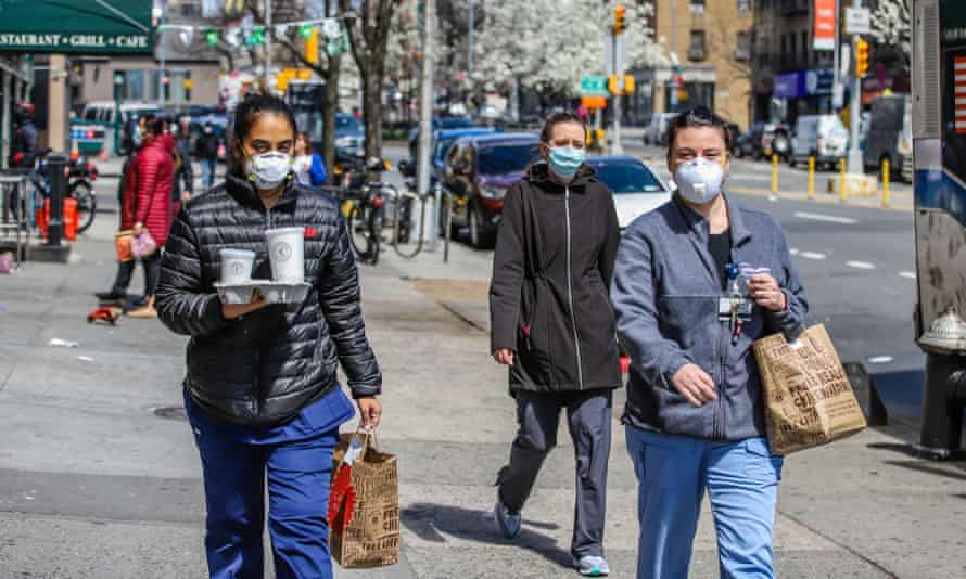people walk with masks in new york
