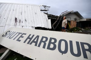 Dave McInerney inspects the damage to his motel at Shute Harbour, Airlie Beach