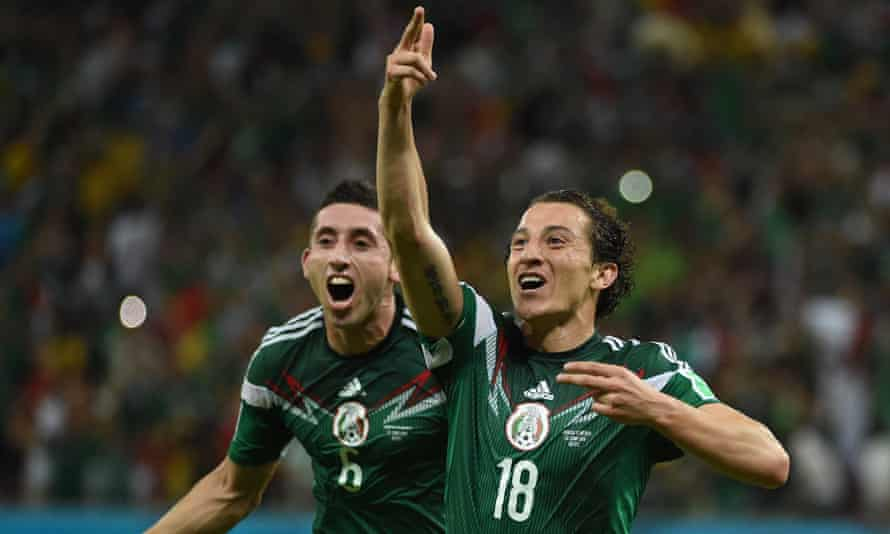 Andres Guardado and Hector Herrera celebrate Mexico's victory over Croatia in the World Cup.