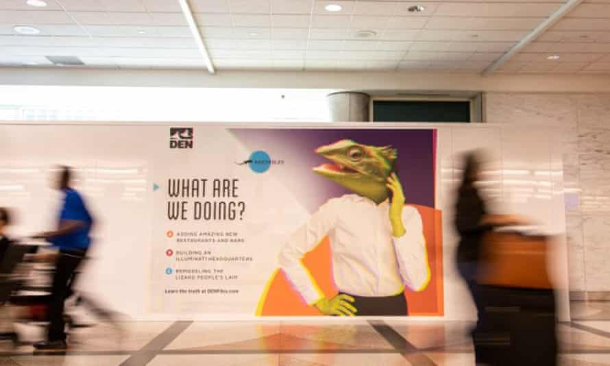 Poster at Denver International Airport questioning what is really going on