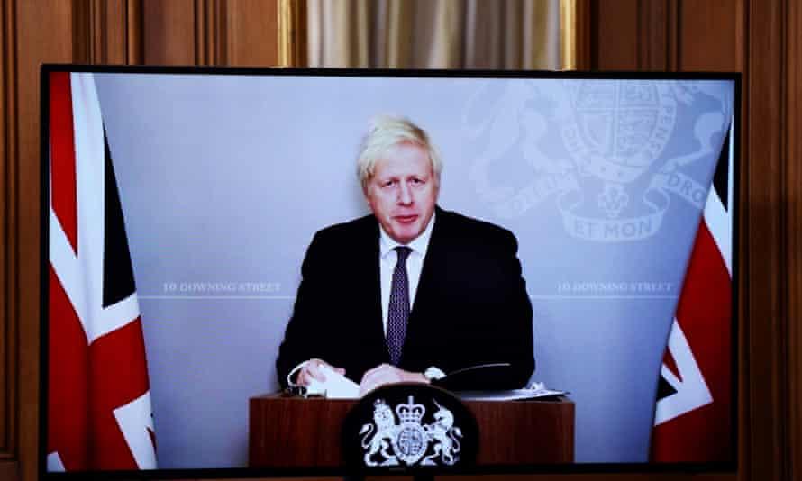 Boris Johnson attends a virtual news conference on coronavirus