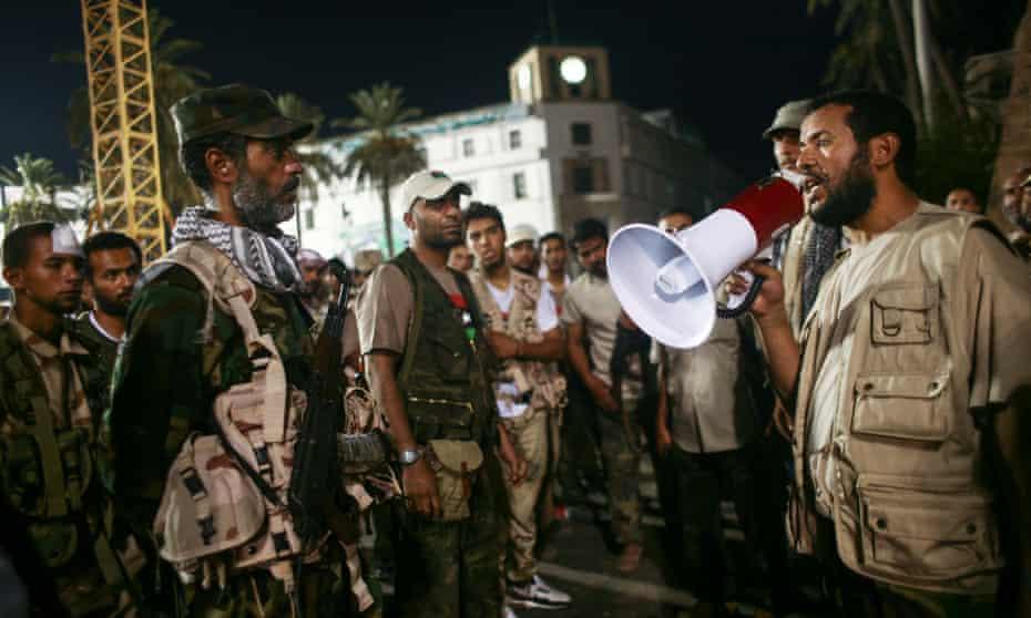 Abdel Hakim Belhaj instructs anti-Gaddafi troops in Triploi in 2011.