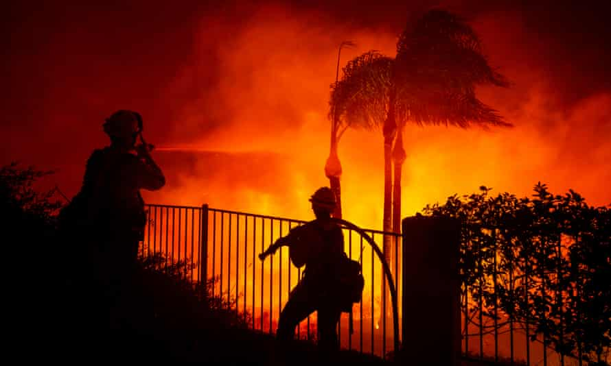 Firefighters work at controlling the spread of the Blue Ridge fire threatening homes in Yorba Linda, Orange county, south of Los Angeles, on Monday.
