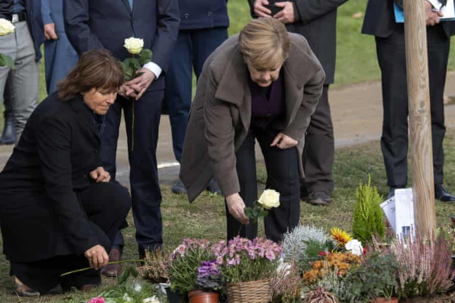 Merkel lays down flowers at a memorial place for victims of the neo-Nazi Nationalist Socialist Underground in Zwickau, November 2019