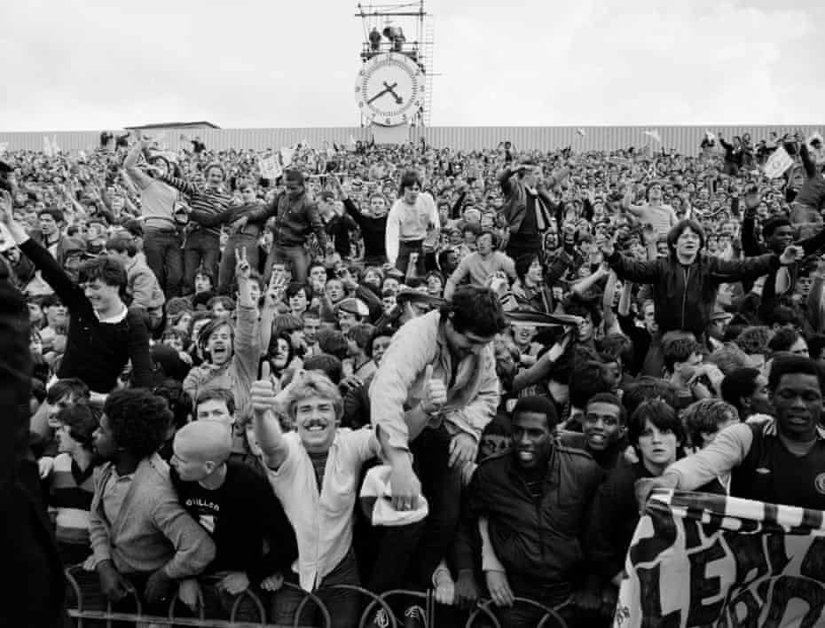 Villa fans begin to celebrate in the Clock End at Highbury after hearing that Ipswich were on the verge of a 2-1 defeat to Middlesbrough.