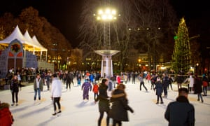 Christmas Market in Oslo. People in the Spikersuppa ice skating rink in middle of town where the Christmas market is also set