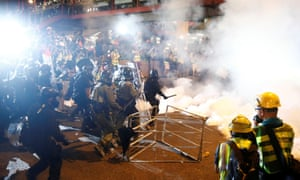 Riot police clash with anti-extradition demonstrators, after a march to call for democratic reforms in Hong Kong.