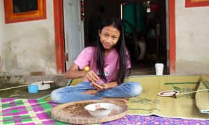 Julaeping Putri, 14, who has worked in Beleke's tobacco fields from a young age.